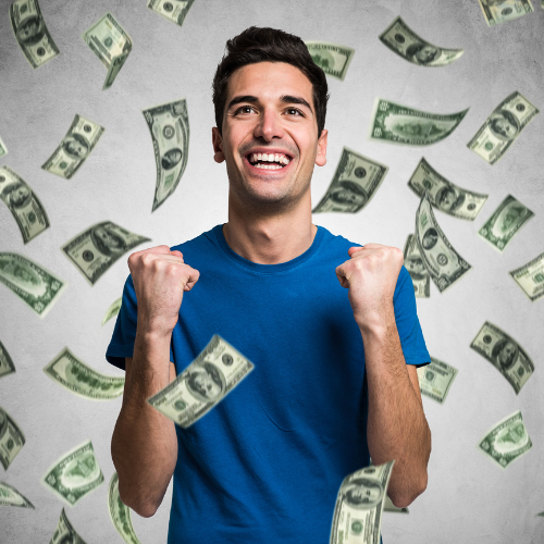 man with dark hair and blue shirt with money raining down
